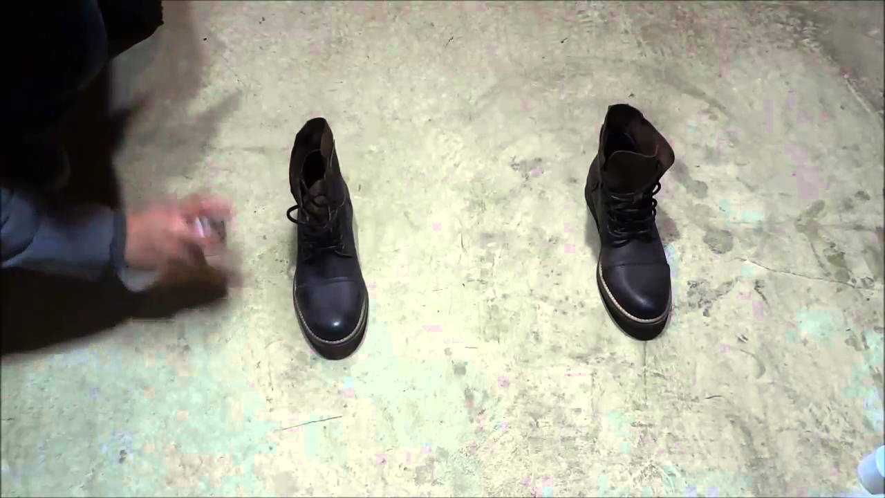 Spraying Men's Boots With Suede Protector